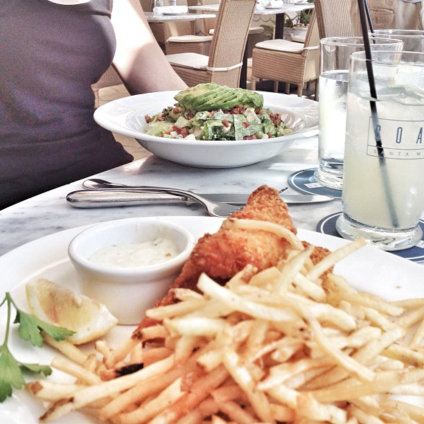 By the beach enjoying some beer battered Halibut and fries with tartar sauce at Coast at Shutters on the Beach.
